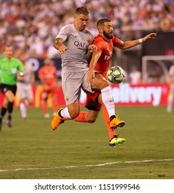 East Rutherford, NJ - August 7, 2018: Karim Benzema (9) of Real Madrid & Aleksandar Kolarov (11) of AS Roma fight for ball during ICC game at MetLife stadium Real won 2 - 1