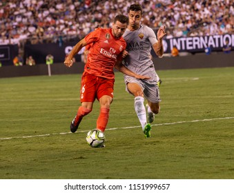 East Rutherford, NJ - August 7, 2018: Nacho (6) of Real Madrid & Ivan Marcano (15) of AS Roma fight for ball during ICC game at MetLife stadium Real won 2 - 1