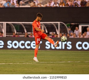 East Rutherford, NJ - August 7, 2018: Marco Asensio (20) of Real Madrid controls ball during ICC game against AS Roma at MetLife stadium Real won 2 - 1
