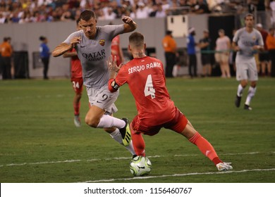 EAST RUTHERFORD, NJ - AUGUST 7, 2018: Edin Dzeko of Roma (L) and Sergio Ramos of Real Madrid #4 in action during the 2018 International Champions Cup match Real Madrid vs Roma at MetLife stadium.