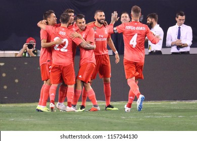 EAST RUTHERFORD, NJ - AUGUST 7, 2018: Team Real Madrid #20 celebrates goal during the 2018 International Champions Cup match against Roma at MetLife stadium. Real Madrid won 2-1