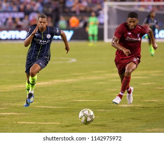East Rutherford, NJ - July 25, 2018: Lukas Nmecha (43) of Manchester City & Joe Gomez (12) of Liverpool FC fight for ball during ICC game at MetLife stadium Liverpool won 2 - 1