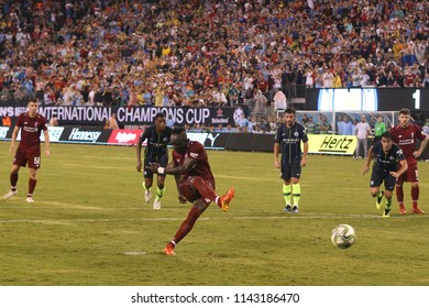 EAST RUTHERFORD, NJ - JULY 25, 2018: Sadio Mane (10) scores a penalty for Liverpool FC against Manchester City during 2018 International Champions Cup game at MetLife stadium
