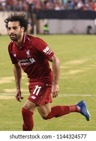 EAST RUTHERFORD, NJ - JULY 25, 2018: Mohammed Salah #11of Liverpool FC in action against Manchester City during 2018 International Champions Cup game at MetLife stadium.