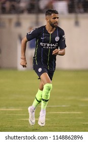 EAST RUTHERFORD, NJ - JULY 25, 2018: Riyad Mahrez of Manchester City in action against Liverpool FC during 2018 International Champions Cup game at MetLife stadium