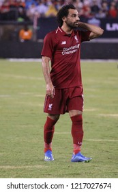 EAST RUTHERFORD, NJ - JULY 25, 2018: Mohamed Salah #11 of Liverpool FC in action against Manchester City during 2018 International Champions Cup game at MetLife stadium.