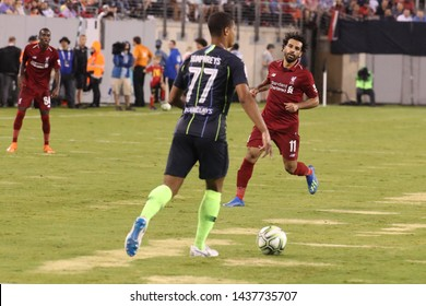 EAST RUTHERFORD, NJ - JULY 25, 2018: Mohamed Salah #11of Liverpool FC in action against Manchester City during 2018 International Champions Cup game at MetLife stadium.
