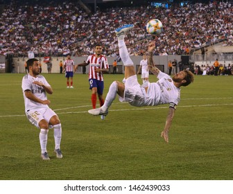 EAST RUTHERFORD, NJ - JULY 26, 2019: Captain and center back Sergio Ramos of Real Madrid #4 performing a bicycle kick during the 2019 International Champions Cup match against Atletico de Madrid