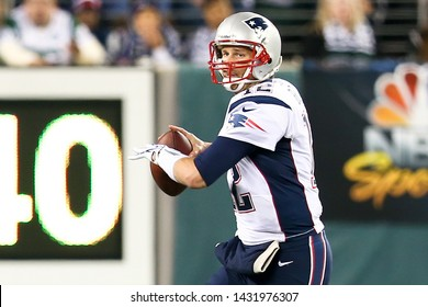 EAST RUTHERFORD, NJ - NOV 22: New England Patriots quarterback Tom Brady looks to throw a pass against the New York Jets at MetLife Stadium on November 22, 2012 in East Rutherford, New Jersey.