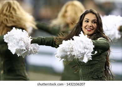 EAST RUTHERFORD, NJ - NOV 22: New York Jets Flight Crew cheerleaders perform during the game against the New England Patriots at MetLife Stadium on November 22, 2012 in East Rutherford, New Jersey.