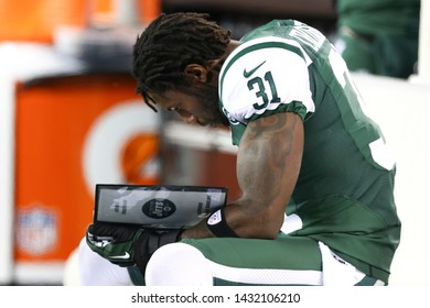 EAST RUTHERFORD, NJ - NOV 22: New York Jets cornerback Antonio Cromartie (31) reads a playbook against the New England Patriots at MetLife Stadium on November 22, 2012 in East Rutherford, New Jersey.