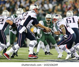 EAST RUTHERFORD, NJ - NOV 22: New England Patriots quarterback Tom Brady (12) hands the ball off to defensive back Nate Ebner (43) at MetLife Stadium on November 22, 2012.