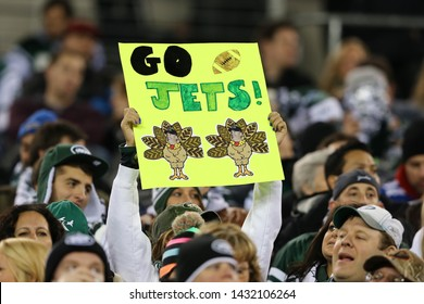 EAST RUTHERFORD, NJ - NOV 22: New York Jets fan holds a sign during the game between the New York Jets and New England Patriots at MetLife Stadium on November 22, 2012 in East Rutherford, New Jersey.