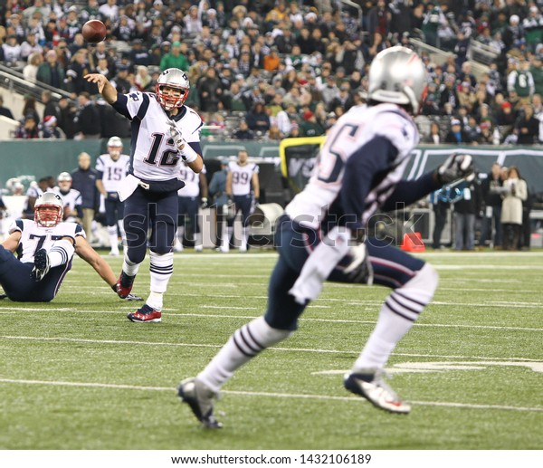 EAST RUTHERFORD, NJ - NOV 22: New England Patriots quarterback Tom Brady (12) throws a pass to wide receiver Brandon Lloyd (85)against the New York Jets at MetLife Stadium on November 22, 2012.