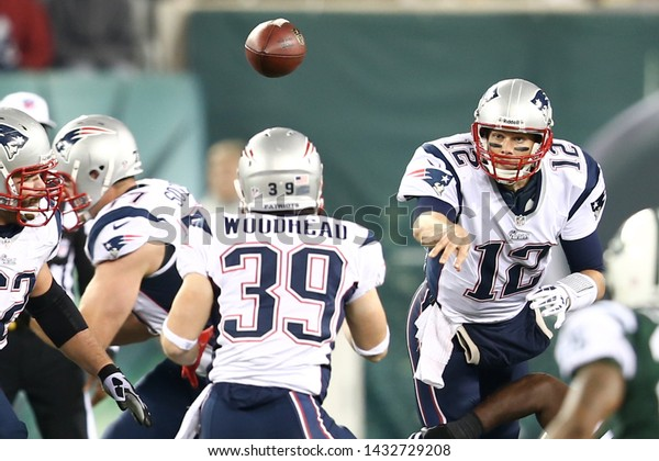 EAST RUTHERFORD, NJ - NOV 22: New England Patriots quarterback Tom Brady (12) throws the ball to running back Danny Woodhead (39) against the New York Jets at MetLife Stadium on November 22, 2012.