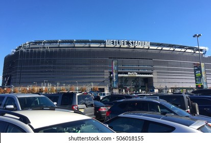 East Rutherford, NJ - October 2016: Metlife Stadium exterior from Parking lot before New York football team game. Fans tailgate outside of cars.