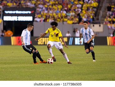 East Rutherford, NJ - September 11, 2018: Juan Guillermo Cuadrado (11) of Colombia controls ball during friendly match against Argentina at MetLife Stadium