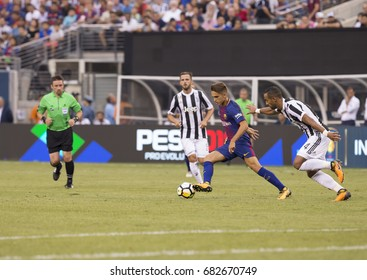 East Rutherford, NJ USA - July 22, 2017: Denis Suarez (6) of Barcelona controls ball during International Champions Cup game against Juventus on MetLife stadium Barcelona won 2 - 1