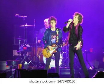 East Rutherford, NJ/USA - August 1, 2019: Singer Mick Jagger and guitarist Ronnie Wood of the Rolling Stones perform on the band's No Filter tour.