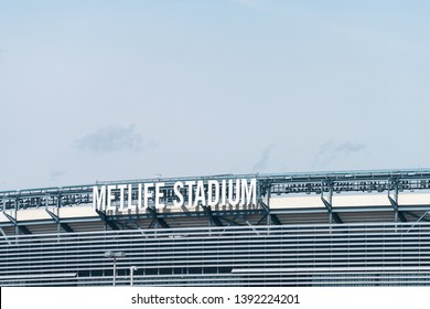 East Rutherford, USA - April 6, 2018: Closeup of sign for Metlife stadium exterior of building in New Jersey