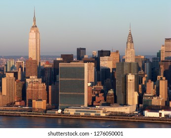 East side of midtown Manhattan, New York City Skyline at Dawn as viewed from Long Island City. Empire State, United Nations and Chrysler Buildings are visible.