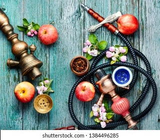 East smoking hookah. Arabian shisha with apple. Hookah and apple.Trendy hookah