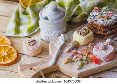 East sweets with fruits, nuts and sugar powder, soft focus background