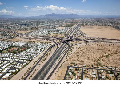 East Valley interchange of the U.S. 60 Superstition freeway and the Loop 202 Red Mountain freeway in Mesa, Arizona looking east with the Superstition Mountains in the distance