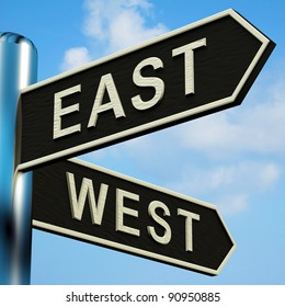 East Or West Directions On A Metal Signpost
