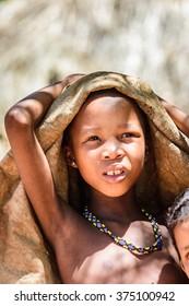 EAST OF WINDHOEK, NAMIBIA - JAN 3, 2016: Unidentified bushman boy. Bushman people are members of various indigenous hunter-gatherer people of Southern Africa