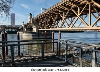 Eastbank Esplanade showing the underside of the Burnside Bridge along the Willamette River in Portland, Oregon December 2017