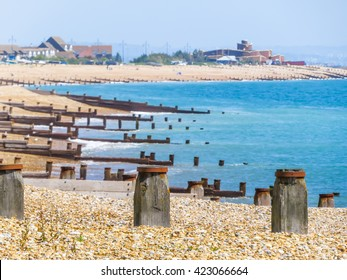 Eastbourne beach at English channel and rows of old breakwaters, United Kingdom