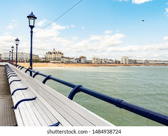 Eastbourne beach and seafront, England. A view of the seafront east of the pier at Eastbourne on the south coast of Britain.