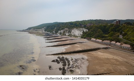 Eastbourne beach and the South Downs, England. An aerial view over the beach and coastline at  Eastbourne, England, where it  edges into the white cliffs and rural South Downs.