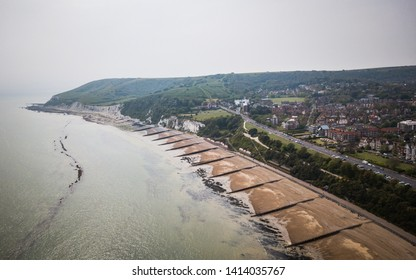Eastbourne beach and the South Downs, England. An aerial view over the Meads area of Eastbourne edging into the white cliffs and rural South Downs.