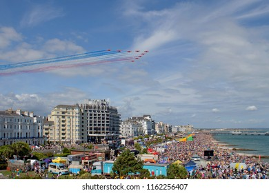Eastbourne, East Sussex, England, UK - 08/17/2018. Airbourne (Eastbourne International Airshow). With much anticipation the Red Arrows arrive over the crowds on the sea front to start their display.
