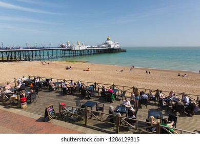 EASTBOURNE, EAST SUSSEX, ENGLAND, UK-APRIL 22nd 2018: Seafront cafes were busy with people enjoying the spring sunshine in Eastbourne, East Sussex, on Sunday 22nd April 2018