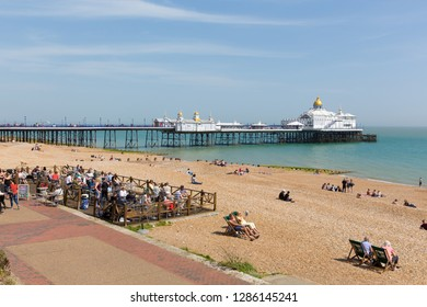 EASTBOURNE, EAST SUSSEX, ENGLAND, UK-APRIL 22nd 2018: Beautiful spring weather attracted visitors to Eastbourne beach, East Sussex, on Sunday 22nd April 2018