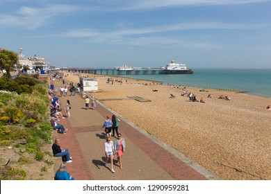 EASTBOURNE, EAST SUSSEX, ENGLAND, UK-APRIL 22nd 2018: People walking on the promenade in beautiful weather in the traditional English holiday town of Eastbourne, East Sussex, on Sunday 22nd April 2018