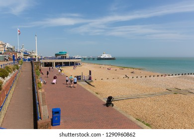 EASTBOURNE, EAST SUSSEX, ENGLAND, UK-APRIL 22nd 2018: People walking on the prom in beautiful weather in the traditional English holiday town of Eastbourne, East Sussex, on Sunday 22nd April 2018
