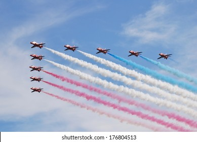 EASTBOURNE, ENGLAND - AUGUST 15, 2013: Royal Air Force aerobatic display team The Red Arrows perform at the Airbourne airshow. The team were first formed in 1965.