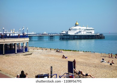 EASTBOURNE, ENGLAND - MAY 3. One of the finest examples of a Victorian pier, Eastbourne's stunning seafront landmark is fully open since the fire of 2014. May 3 2018 in Eastbourne, England.