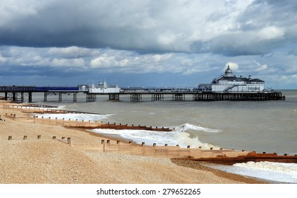 Eastbourne Pier and beach, East Sussex, England, UK. Eastbourne is a large town, seaside resort.