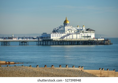 Eastbourne pier in calm sunny weather, a