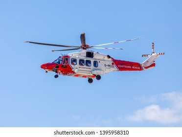 Eastbourne, Sussex, UK. 12th May 2019. HM Coastguard helicopter searches Beachy Head in Sussex