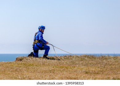 Eastbourne, Sussex, UK. Eastbourne, Sussex, UK. 12th May 2019.  Coastguard crews set up a rope rescue line at Beachy Head