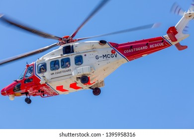 Eastbourne, Sussex, UK. 12th May 2019. HM Coastguard Helicopter departs from Beachy head after a search