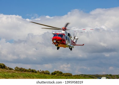 Eastbourne, Sussex, UK. 1st Jan 2019.  HM Coastguard helicopter comes in to land at Beachy Head