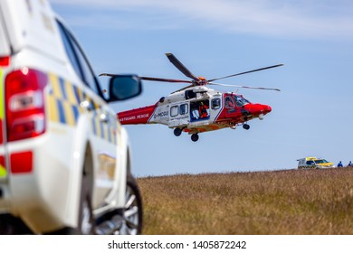 Eastbourne, Sussex, UK. 23rd May 2019. Coastguard helicopter takes off with a coastguard 4x4 vehicle in the foreground
