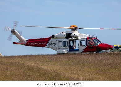 Eastbourne, Sussex, UK. 23rd May 2019. Coastguard helicopter landing at Beachy Head